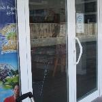 Smashed window of Brisasol office, angry customer perhaps?
