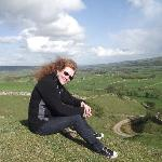 my wife sitting on top of the hills backyarding the wheatsheaf