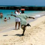 One of the Bartenders serving drinks on the beach while balancing on his head! Funny!