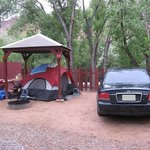Partial covered tent site