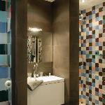 The hidden bathroom in basalt nature stone