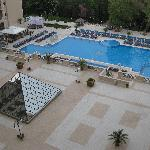 view of the pool and restaurant pyramid ceiling