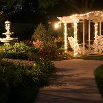 Swing and fountain at night
