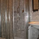 the clean bathroom with a lovely shower