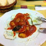 ravioli with peanuts and gorgonzola sauce with pomodoro white beans