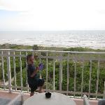 My son looking at the ocean from the balcony