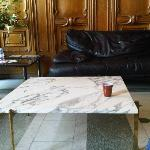 Dirty tables and worn furniture in the lobby