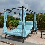 double chaises by the pool to relax on