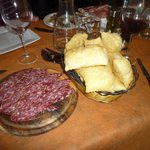 The antipasti:Traditional Gnocco Fritto with salami