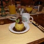 Baked apple with maple-pecan sauce, 1st course for breakfast at Butterfield B&B, Julian, Ca.