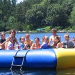 Kids all having a great time playing on the raft