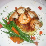 Prawns with mashed potatoes and green beans.