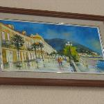 Painting of boulevard in lobby