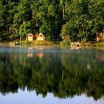 Cabin setting reflecting in Pennyrile Lake