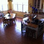 Kitchen island and dining area shot from the stairs.