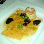 Salmon carpaccio with freshly shaved truffle
