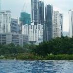 Panoramic view of the city across the pool