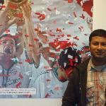 Infront of a poster of Bayern Munich Triumph
