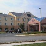 Front view of hotel. Back rooms look at woods. Front view looks at shopping centers.