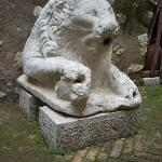 A carved limestone lion in the palazzo's courtyard.