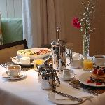 Warwick House Breakfast, Pancakes and Fresh Fruit platters on the menu.