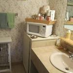 Sweet little vanity area with microwave, coffee maker and glasses, mugs , hair dryer and much mo