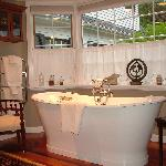 Relax in the Italian Soaking Tub Overlooking the Pool Courtyard. - The Welsh Hills Inn