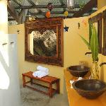 Beautiful outdoor bathroom. Surrounded by rock and jungle.