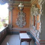 Balcony facing the garden features Balinese carvings