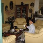 Alisa taking tea in the drawing room