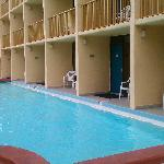 the rooms with balconies leading into the pool