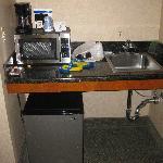 Fridge, microwave, sink, and coffee maker