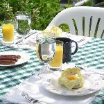 Breakfast featured here is Cornish Baked Eggs and sausages, orange juice and a great cup of coff