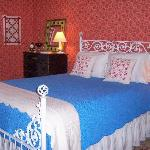 The Red Room is cute and cozy with its antique iron Queen bed.  Sharing a bath with the Green Ro