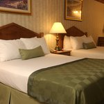 Spacious Double Queen Guest Room equipt with refrigerator and microwave. Jetted bathtubs in the