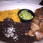Carnitas with black beans rice and guacamole