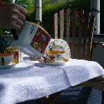 Afternoon tea with homamade cake on the porch