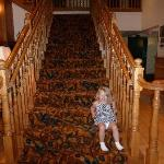 My daughter~ Sitting on stairs in entry way
