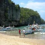 Boat docks by the beach within a few yards away from the entrance of the Underground River
