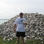 Hubby standing by one of the conch piles