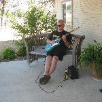 A guitar, a Shiner longneck and a porch. It don't get no better!