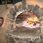 Pizza in wood-fired clay oven