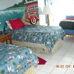 The teen room was decorated so well with surf motif.
