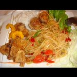 super spicy papaya salad with some fried chicken.