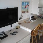 Big screen TV and kitchenette in living room