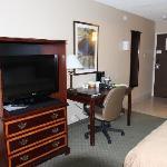 TV, desk, and entryway