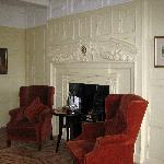 The fireplace,panelling and picture's