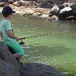 our grandson learning how to catch fish