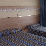 Habitación triple (cama matrimonio + individual)