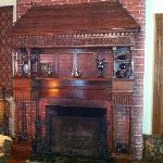 Can you believe that this amazing mantel was once covered by 10 layers of paint?